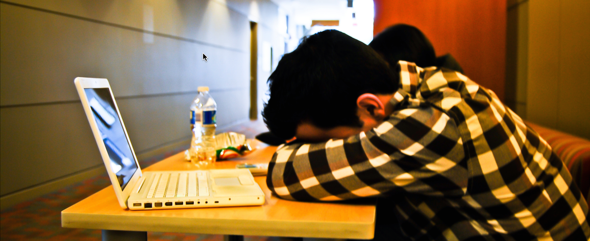 student with his head down on a table