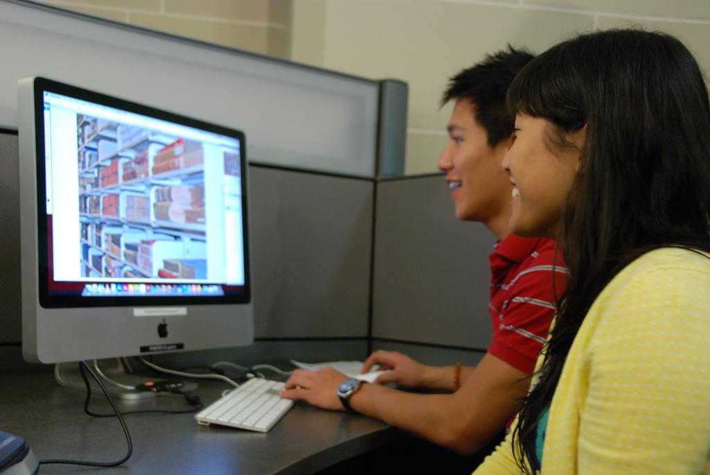 2 people enjoying computers