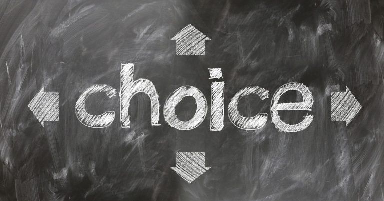 'Choice' written on chalkboard with arrows leading in different directions around it