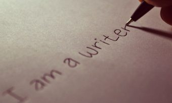 'I am a writer' written on paper