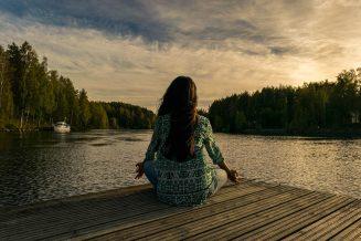 a person looking at the lake meditating