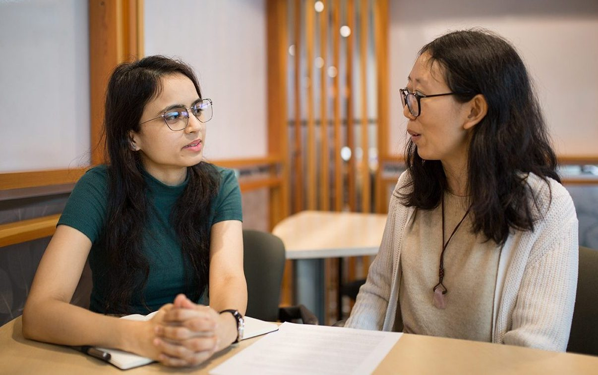 A student in conversation with a writing consultant